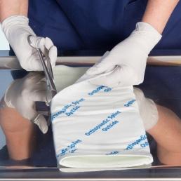 Splint on a roll being cut.